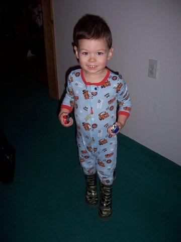 Cars + boots = happy boy