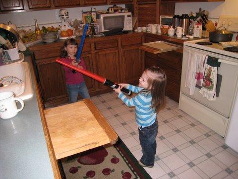 A cousins' lightsaber duel