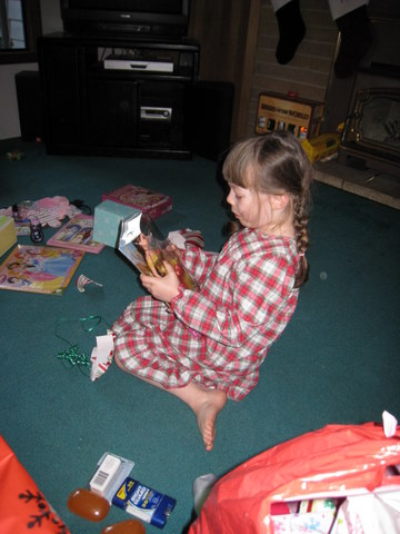 Ane opens her presents