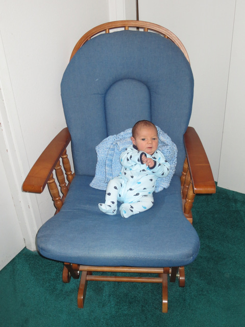 In the chair at one month old