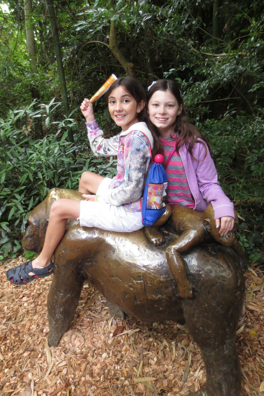 Being silly with the gorilla statues