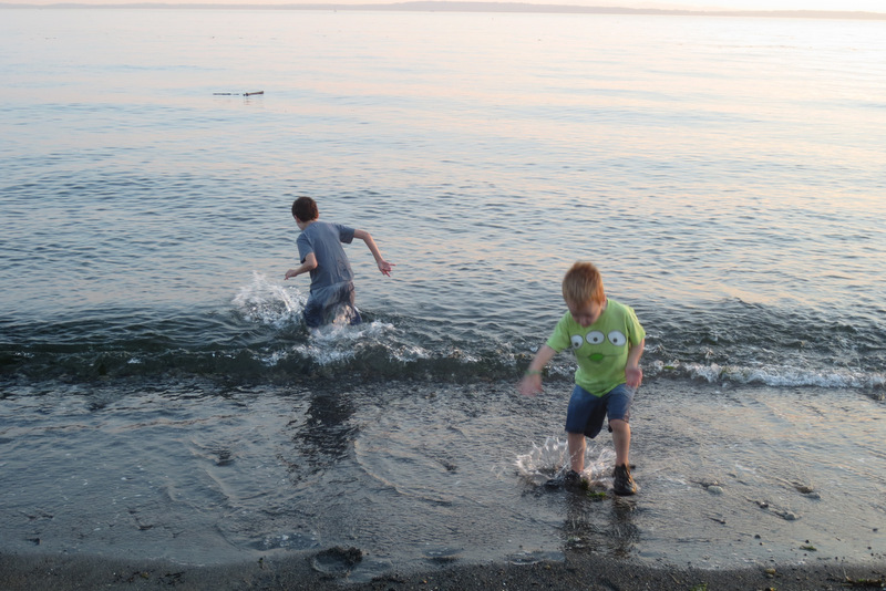 Tad and Rupert dash into the waves