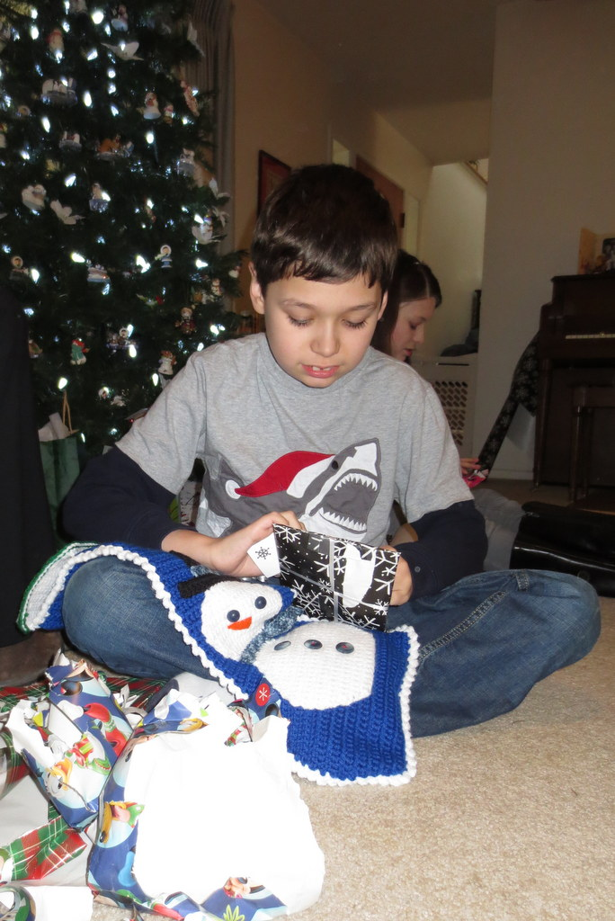 Tad opens his stocking gifts