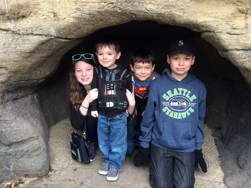 Kids at the penguin exhibit cave