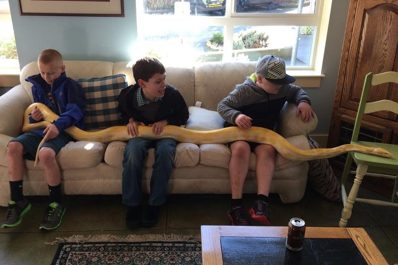 Tad and kids hold a python