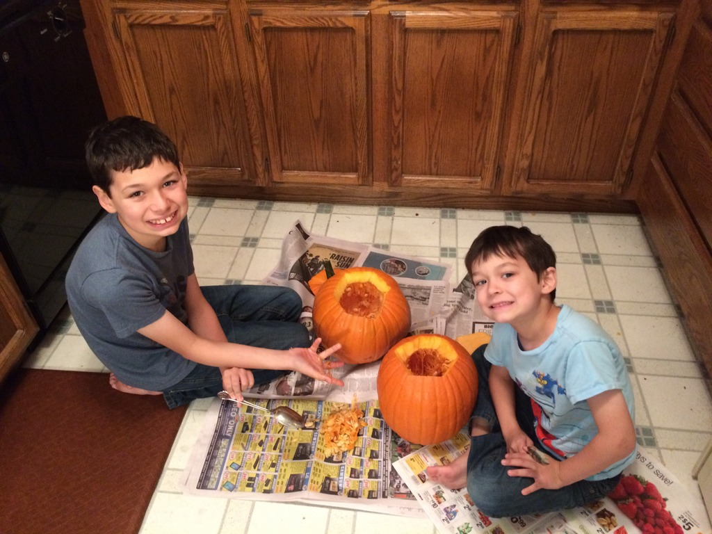 Boys sit down with their pumpkins